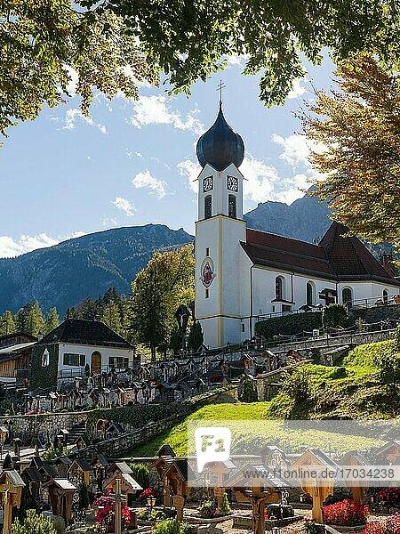 Church St. Johannes der Taeufer (John the Baptist). Village Grainau near Garmisch-Partenkirchen and mount Zugspitze in the Wetterstein mountain range. Europe  Central Europe  Germany.