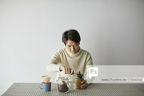 Japanese man making coffee at home
