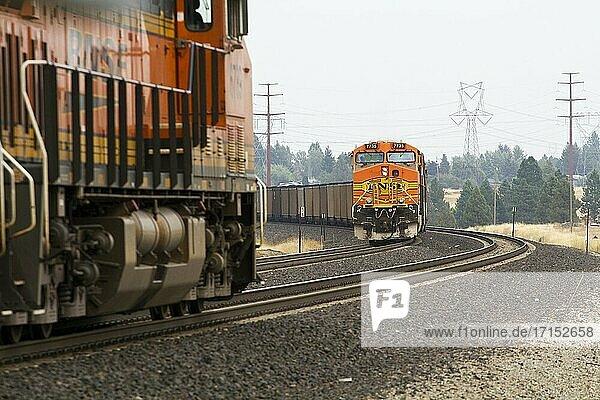 BNSF coal train and intermodal train (foreground) in Spokane  Washington  USA.