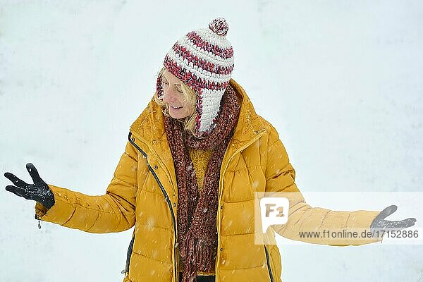 Caucasian young woman enjoying snow outdoor in winter time. Navarre  Spain  Europe.