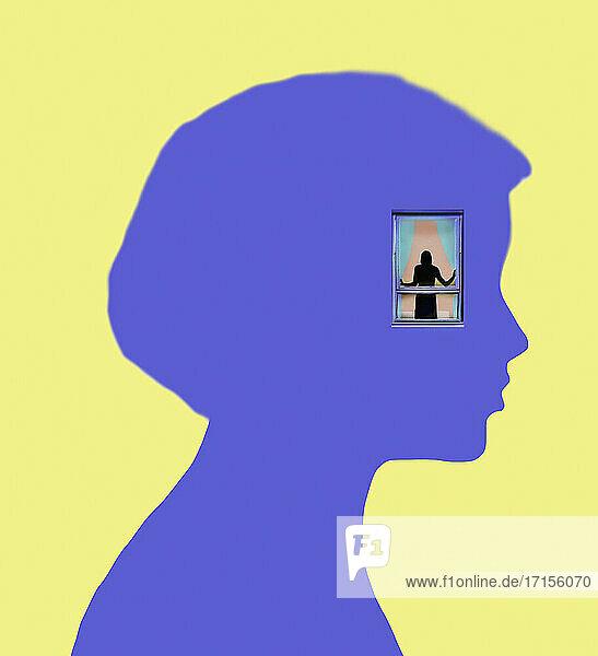 Figur schaut aus dem Fenster in einem Kopf