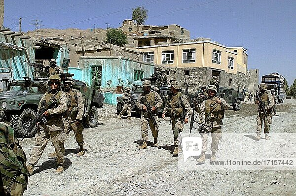 AFGHANISTAN Surobi -- 23 May 2004 -- Marines from Company I  3rd Battalion  6th Marine Regiment  patrol on foot through downtown Surobi  Afghanistan. The battalion is conducting security patrols and civil assistance operations throughout the region looking for Taliban insurgents. US Army photo (Released) -- Picture by Justin M Mason / Lightroom Photos / US Army.