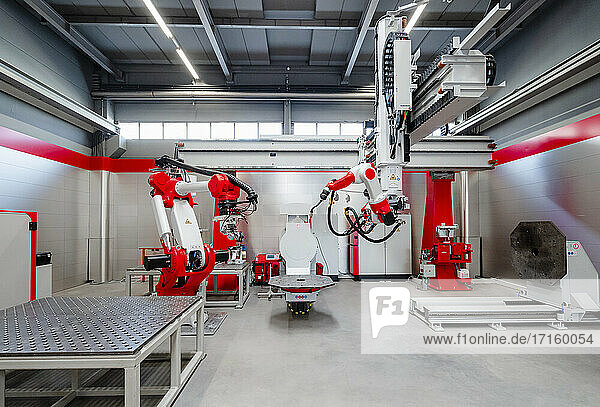 Automatic industrial robots for welding at factory