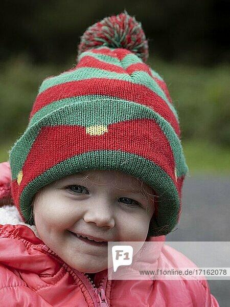 Toddler wearing a bobble hat  UK.