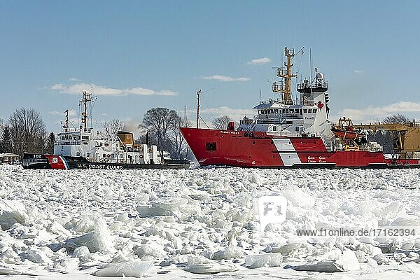 Roberts Landing  Michigan - The Canadian Coast Guard icebreaker Samuel Risley and the U. S. Coast Guard Cutter Bristol Bay work together to break up ice on the St. Clair River. Bitter cold has led to ice jams on the river and flooding in shoreline communities. The St. Clair River is the border between the U. S. and Canada  it drains the upper Great Lakes towards Lake St. Clair and on to Lake Erie.