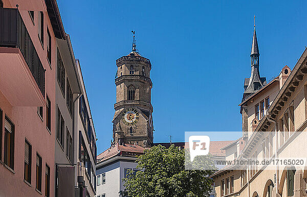 Germany  Baden-Wurttemberg  Stuttgart  Bell tower of Stiftskirche church with houses in foreground