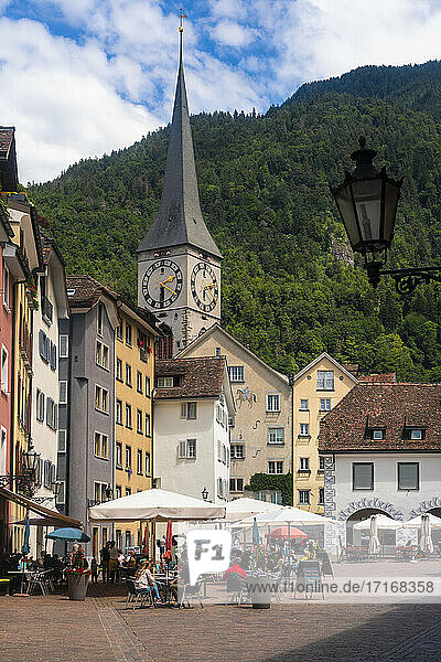 Arcas Square with the spire of St martin church in the background against mountain at Chur  Switzerland