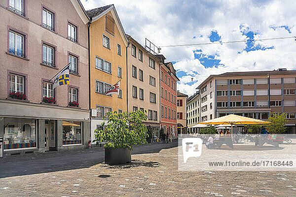 Kornplatz square with restaurants and cafes against cloudy sky at Chur  Switzerland