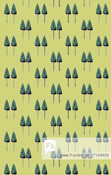 Pattern of tree-shaped lollipops against yellow background