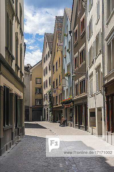 Narrow alley with row house in old town of Chur  Switzerland