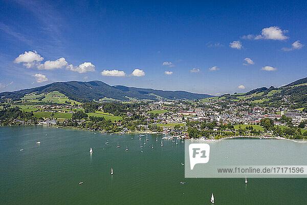 Austria  Upper Austria  Mondsee  Aerial view of sailboats sailing near coast of lakeshore town in summer