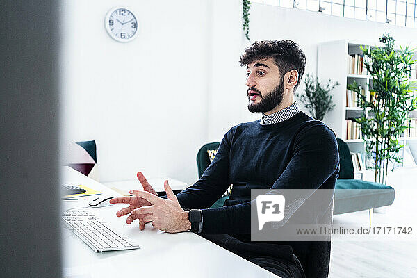 Businessman having video conference in office
