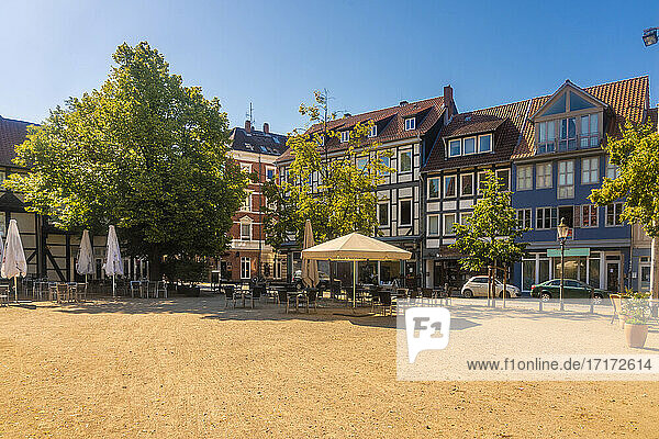 Germany  Lower Saxony  Brunswick  Historic half timbered houses surrounding empty square in Magniviertel quarter