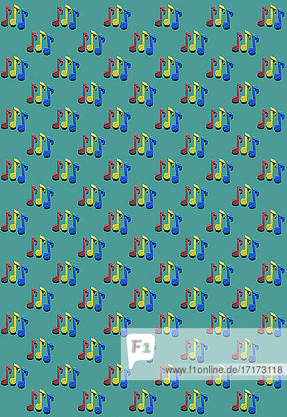 Pattern of red  blue and yellow origami notes against green background