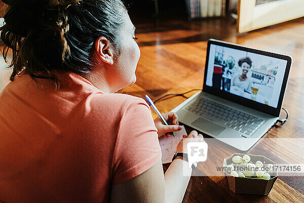 Young woman taking remote learning course