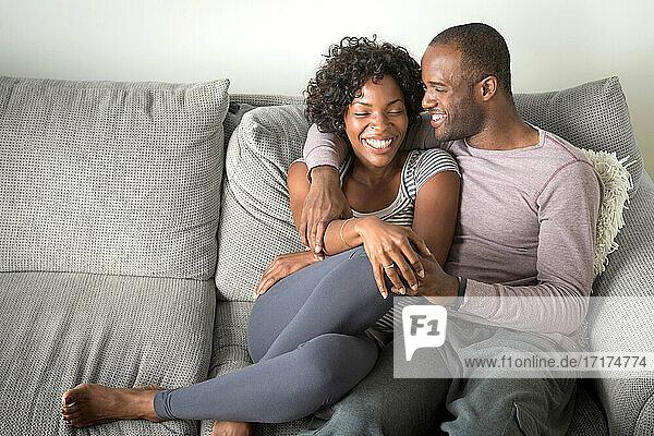 Portrait of mid adult couple sitting on sofa