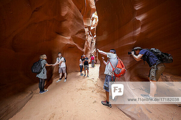 Tourists explore a slot canyon in Upper Antelope Canyon  Navajo Land  Arizona  United States of America  North America