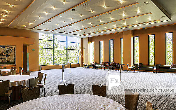 Large empty room in a hotel or conference centre  tables and chairs.