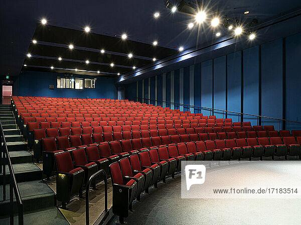 Empty auditorium  rows of raked seats.
