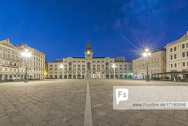 The empty piazza of Unity of Italy square  historic buildings and street lights.