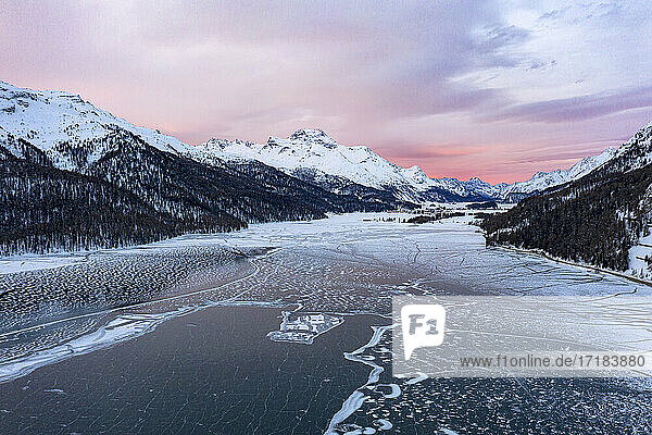 Sunrise on the snowcapped mountains and frozen Lake Silvaplana  aerial view  Maloja  Engadine  Graubunden canton  Switzerland  Europe