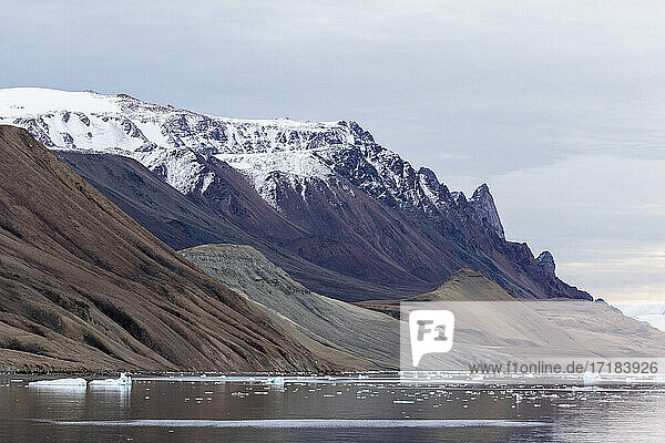 Reflections in the calm waters of Makinson Inlet  Ellesmere Island  Nunavut  Canada  North America