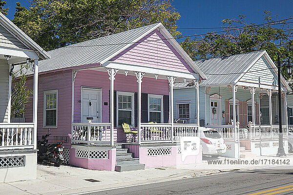 Typical pastel-coloured wooden houses on Truman Avenue  Old Town  Key West  Florida Keys  Florida  United States of America  North America