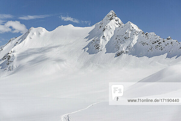 Mid distant view of person on snowcapped mountain during vacation
