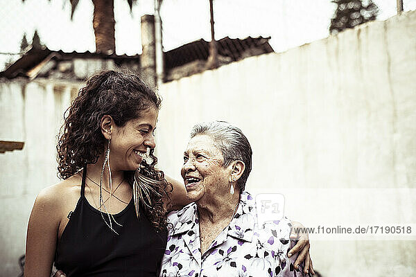 Smiling embrace in a bright summer day of Mexican women in family