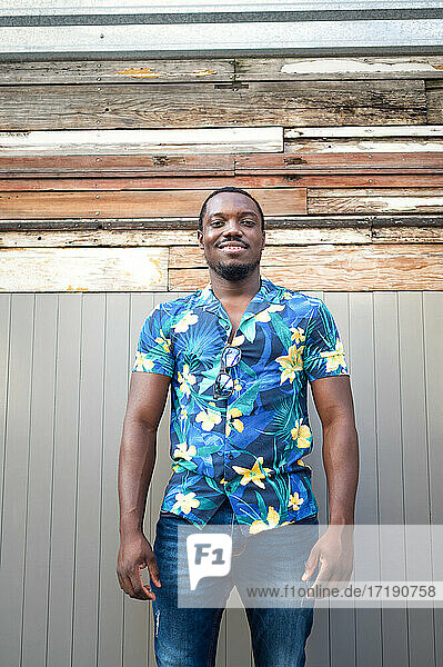 A young black man in street. Outdoor portrait of traveler.