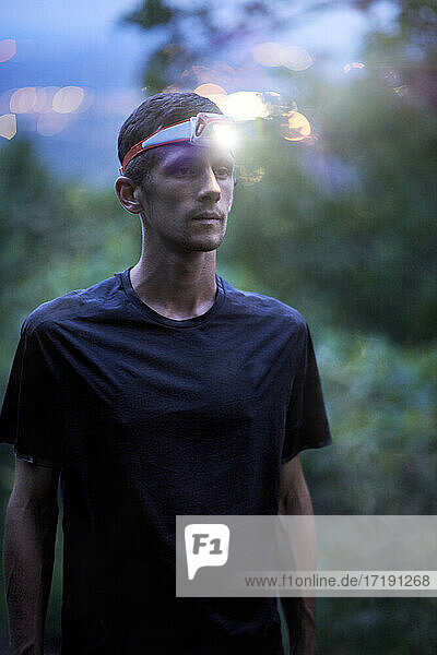 Portrait of a young adult man trail runner on a Mountain Ridge