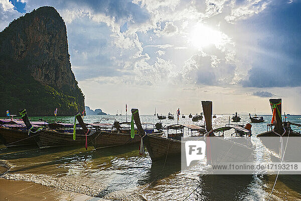 traditional longtail boats parked at the beach in Railay