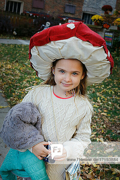 A girl dressed up as a mushroom for Halloween