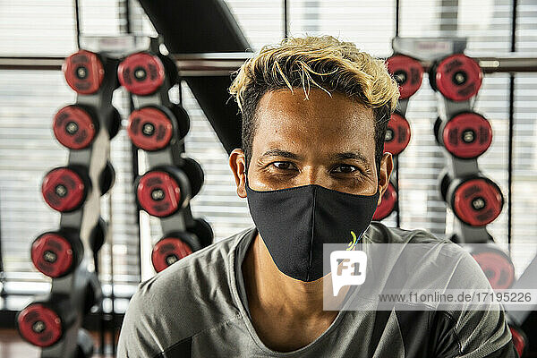 Portrait of Gym Trainer Smiling Under Mask Before Working Out