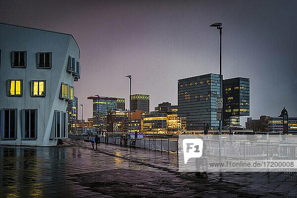 Germany  North Rhine Westphalia  Dusseldorf  Media Harbor in rain at dusk