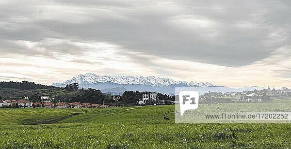 Spain  Cantabria  Tonanes  Cloudy sky over rural town in Picos de Europa