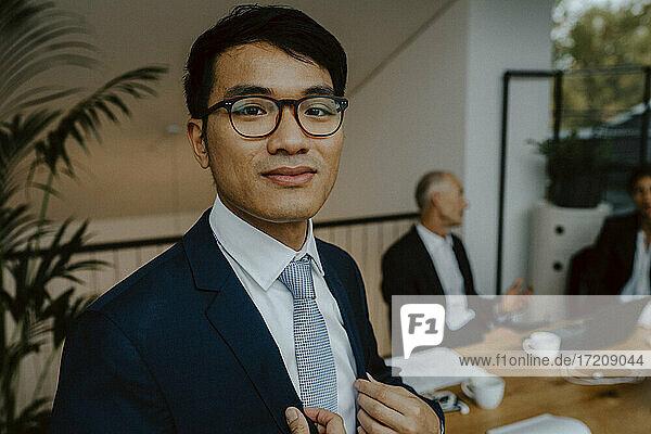 Portrait of male entrepreneur in board room at office