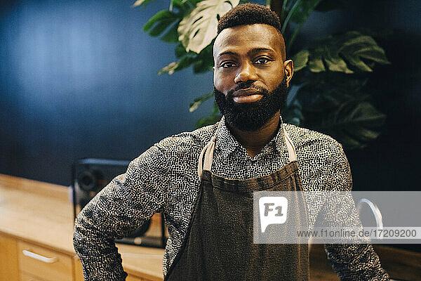 Portrait of male entrepreneur in coffee shop