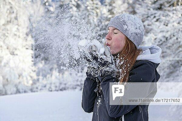 Woman enjoying the snow during winter walk  winter with snow  snowy landscape  Bad Heilbrunn  Upper Bavaria  Bavaria  Germany  Europe