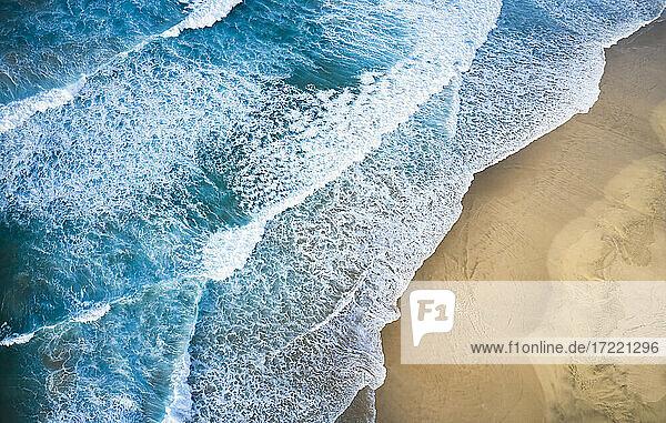 Spain  Canary Islands  Fuerteventura  Aerial view of waves stroking sandy beach Playa de Cofete