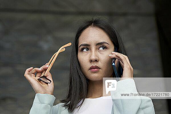 Female entrepreneur looking away while talking on phone