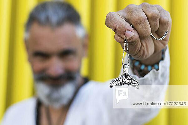Man showing fish tail locket