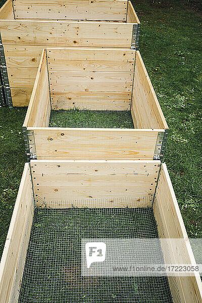 Wooden crates on grass at garden