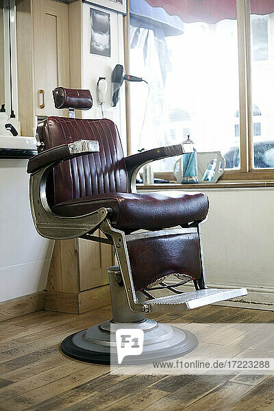 Empty chair inside barber shop