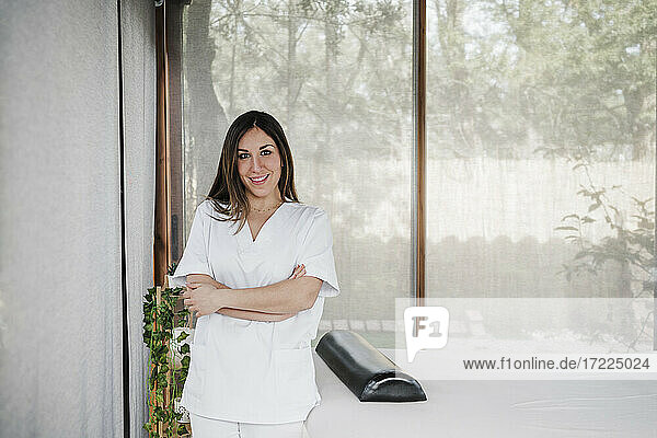 Smiling female doctor standing in clinic