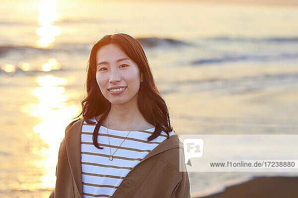Young Japanese woman at the beach