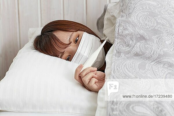 Japanese woman sick in bed
