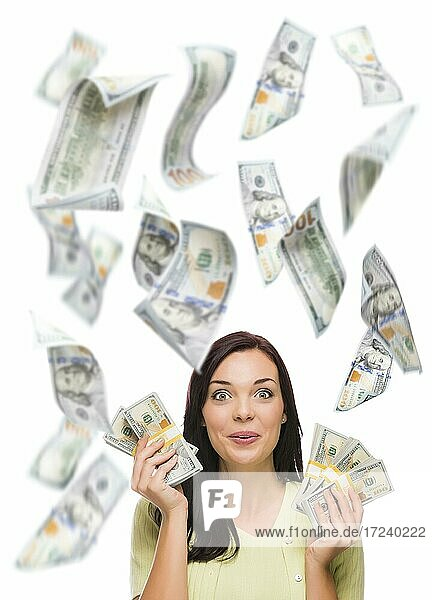 Celebrating young woman holding $100 bills with many others falling around her on white