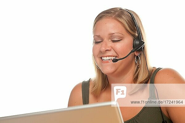 Attractive businesswoman smiles as she talks on her phone headset