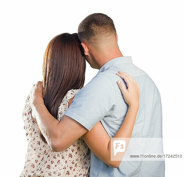 Affectionate military couple from behind hugging looking away isolated on white